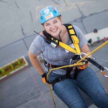 Elizabeth, ever the adventurer, smiles for the camera while rappelling.