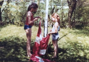 Lea as a kid (right) with her cousin, getting ready to raise the Danish flag
