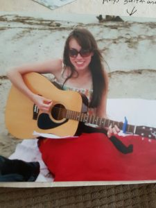 Sharry playing guitar