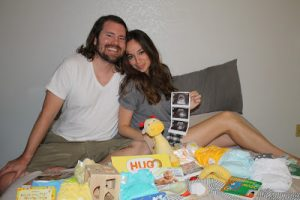 Jared and Sharry with their ultrasound photos