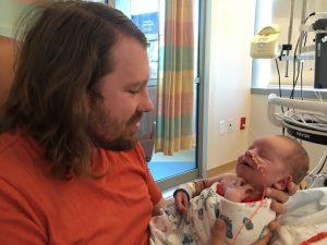 Jared with newborn JJ in the NICU